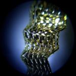 microscope photo of a tiny gold ribbon